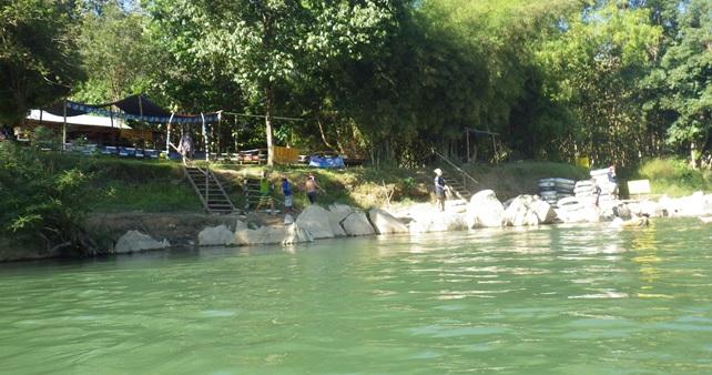 Bar along the river while tubing in Vang Vieng, Laos