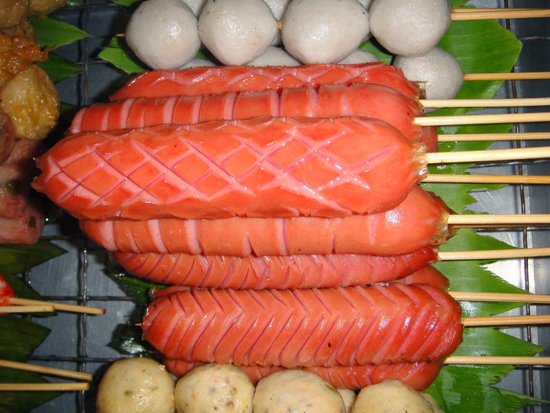 Sausages on sticks – Street food in Bangkok, Thailand