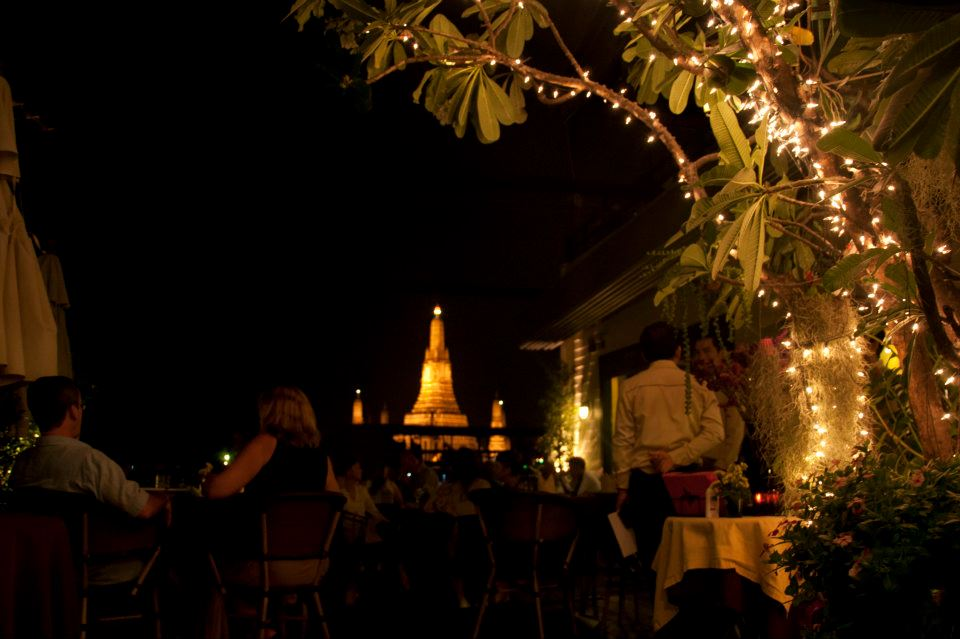 Dinner on Chao Phraya river front with a view of Wat Arun