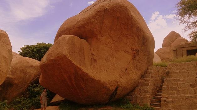 San's 6-2 frame looks tiny next to Hampi's Giant Boulder