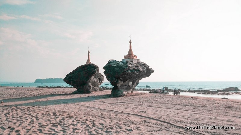 Pagodas on rocks on Ngwe Saung Beach in Myanmar