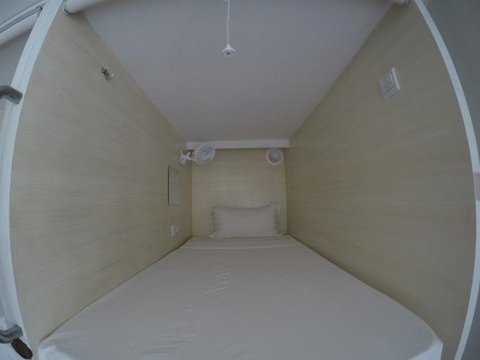 Inside a capsule at Tambayan Capsule Hostel, Manila