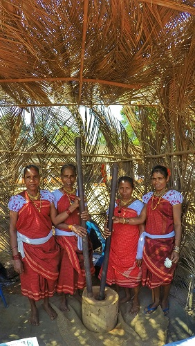 A few tribal women using traditional methods for grinding at Goa Tribal Festival