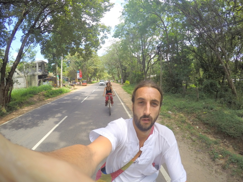 San and I riding a bicycle in Sri Lanka