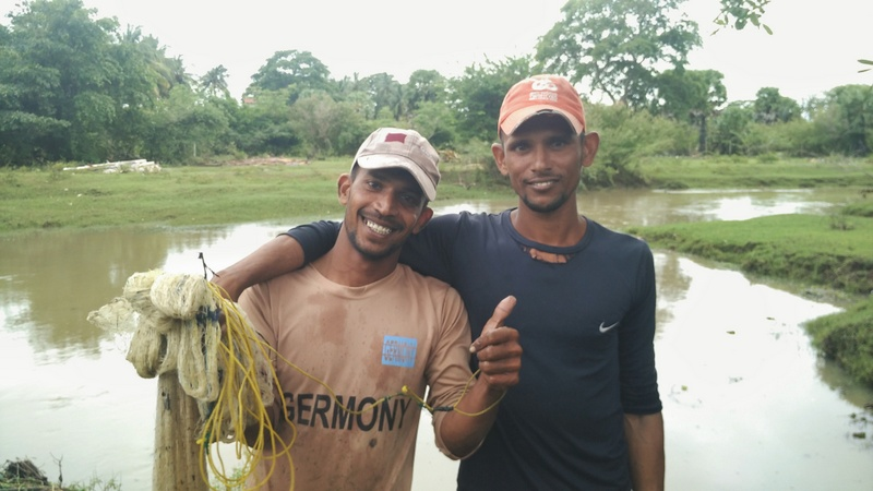 Munash and his friend after fishing in Arugam Bay