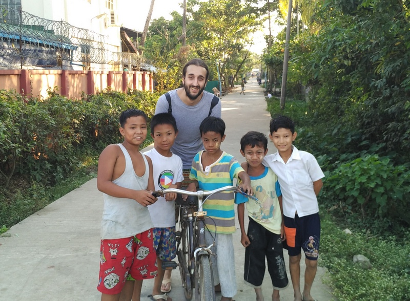 San with a group of Burmese boys in Dala Village