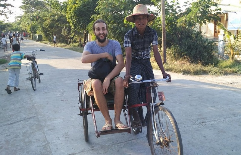 San enjoying his tricycle ride in Dala Village, Myanmar