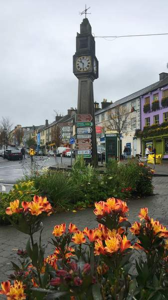 Flowers and Clocktower in the town of Westport, Ireland