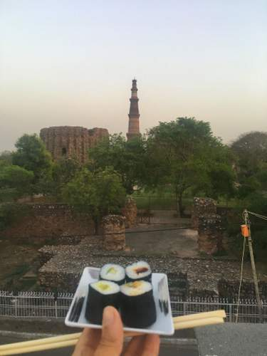 Eating Sushi with a view of Qutub Minar from En Restaurant in Mehrauli, Delhi