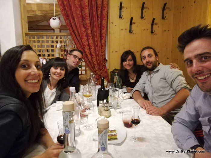 San and I enjoying a cozy dinner with the locals in Pineta Hotel, Val di Non, Italy