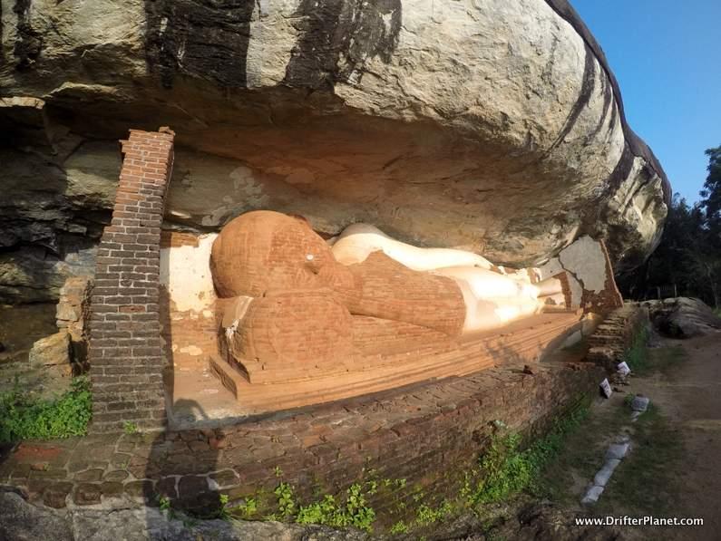 A massive reclining Buddha Statue in a cave in Pidurangala, Sigiriya village