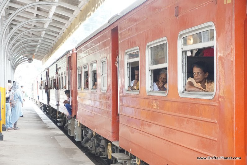 A local train in Sri Lanka with red coaches
