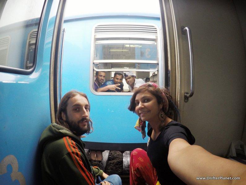 San and I enjoying the door seat on a train in Sri Lanka