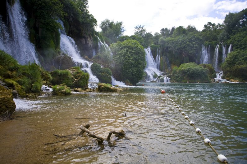 Swimming inside Kravice Waterfalls - safety rope