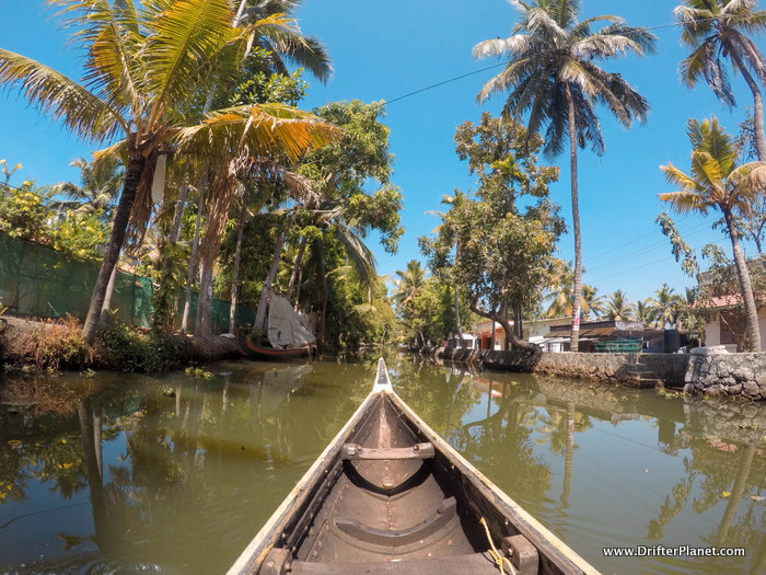 Canoeing in a narrow canal in Alleppey backwaters where houseboats can't go
