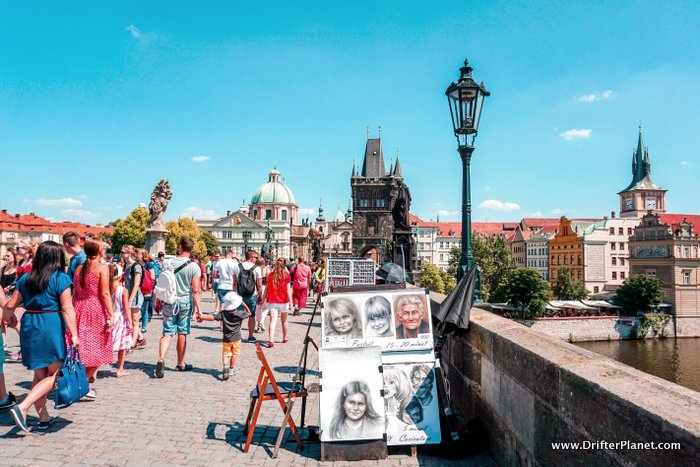 Caricature artist on Charles Bridge, Prague