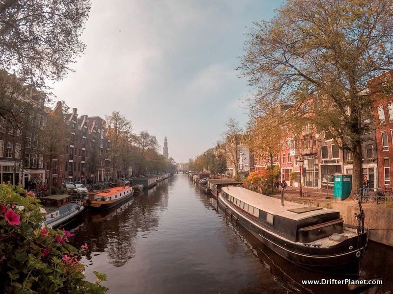 Amsterdam's canals, bridges, boats and narrow houses