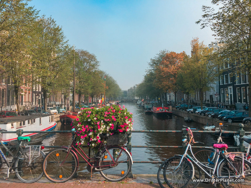 Flowers, canals, narrow buildings and bicycles - typical Amsterdam
