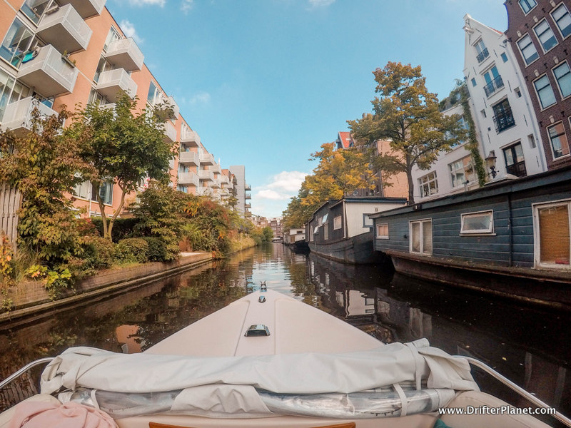 View of a canal in Amsterdam from a small boat