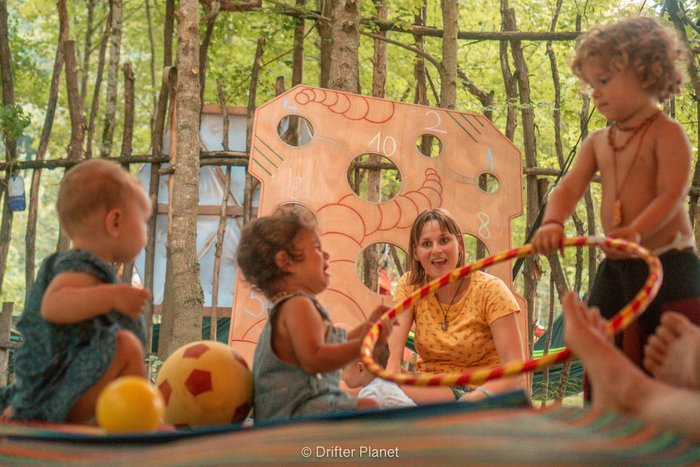 Toddlers and babies playing together in the Children's Area in a music festival