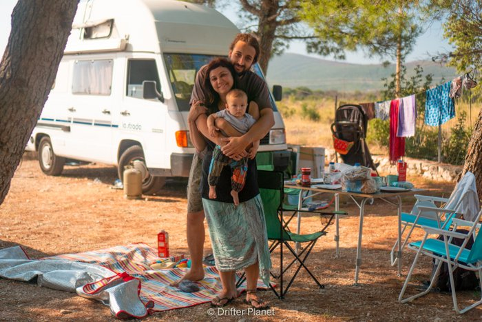 Us three with van and our camping spot - traveling with a baby