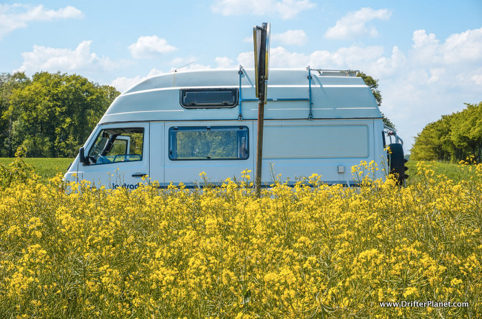 Our Camper van parked near a yellow flower field in Germany
