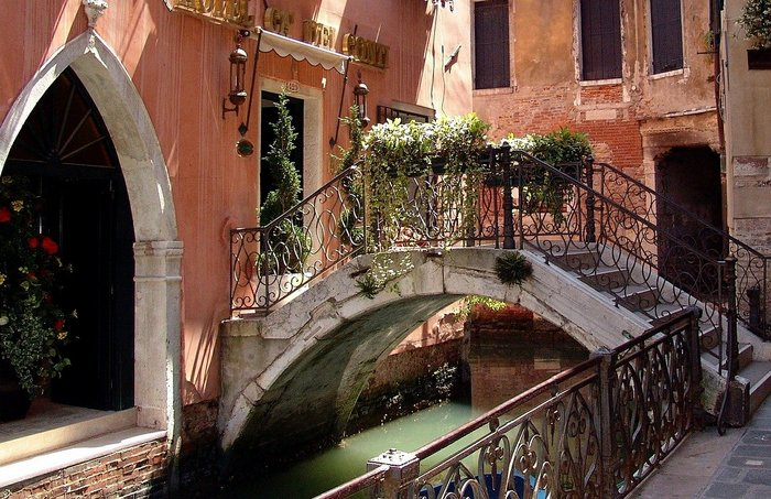 A bridge over a pretty canal in Venice, Italy